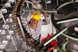 trabalhador têxtil americano africano foto