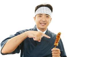 chef asiático sorridente foto