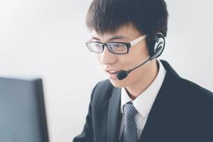 operador de negócios asiáticos foto