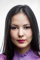 menina asiática jovem pensativa foto
