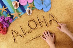 aloha escrita de praia foto