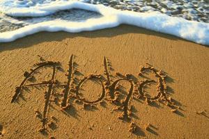 aloha na areia foto