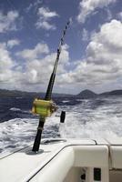 vara de pesca em alto mar barco no Havaí foto