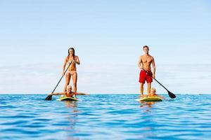 diversão em família, stand up paddle foto