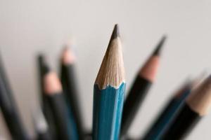 lápis verticais