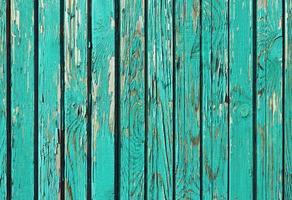 velhas pranchas de madeira surradas com tinta rachada, fundo retrô foto