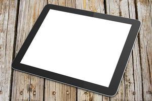 tablet digital em branco em uma mesa de madeira foto