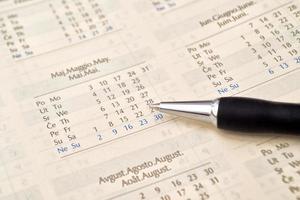 lápis e calendário foto