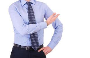 empresário, gesticulando com a mão. foto