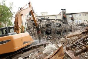 demolição de construção de máquinas de negócios foto