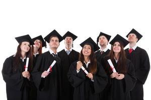 grupo sorridente feliz de graduados multiétnicas foto