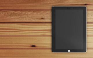 local de trabalho com computador tablet moderno na mesa de madeira foto