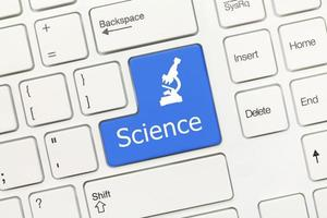 teclado conceitual branco - ciência (tecla azul) foto