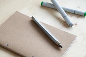 Nota de desenho de caderno de lápis para negócios e educação foto