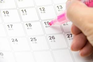 calendário e caneta foto