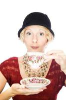 retrato de senhora bonita bebendo chá foto