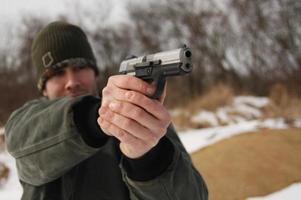 pistola apontando foto