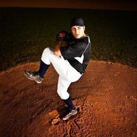 jarro (tiro de ação de beisebol) no monte foto
