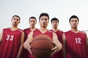time de basquete, retrato foto