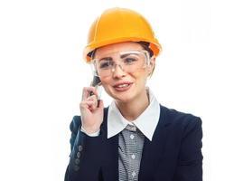 mulher de engenheiro sobre fundo branco foto