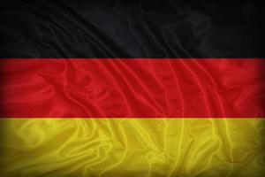 padrão de bandeira da Alemanha sobre a textura do tecido, estilo vintage foto