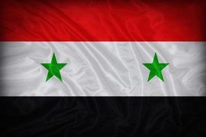padrão de bandeira da Síria sobre a textura do tecido, estilo vintage foto