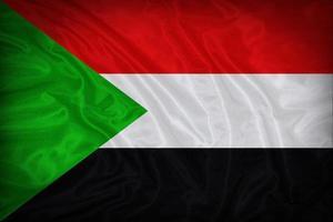 padrão de bandeira do Sudão sobre a textura do tecido, estilo vintage foto
