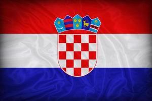 padrão de bandeira da Croácia sobre a textura do tecido, estilo vintage foto