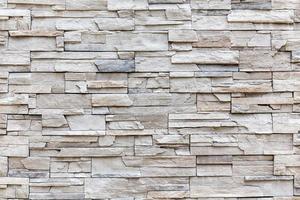parede de tijolo de rocha exterior, padrão de parede de fundo. foto