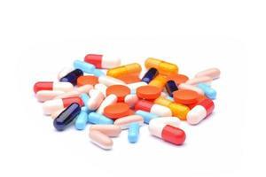 comprimidos coloridos com cápsulas foto