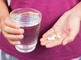 pílulas na mão foto