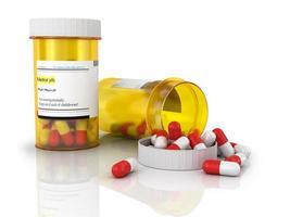 comprimidos um frasco de comprimidos no fundo branco foto