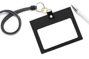 cartões de identificação e caneta esferográfica. foto