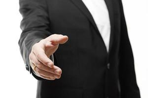 o empresário agindo apertar a mão no fundo branco foto
