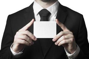 empresário segurando cartaz em branco foto
