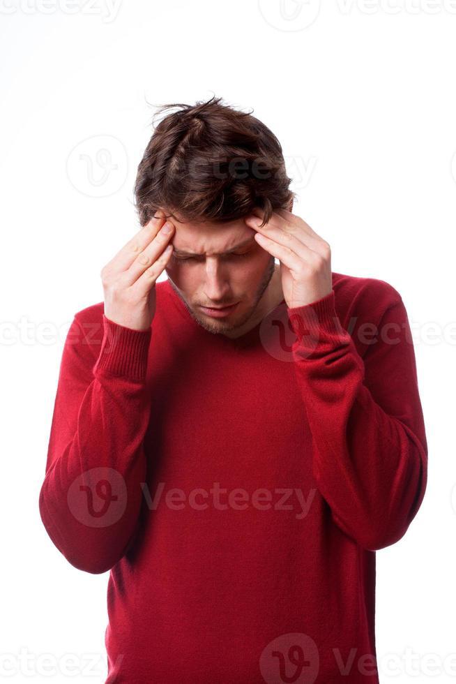 Mann mit Kopfschmerzen foto