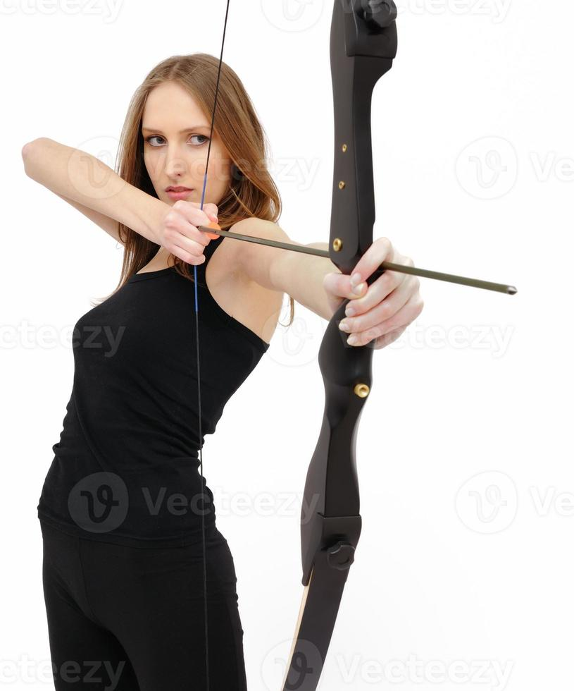 Konzentration - Frau mit Bogen foto