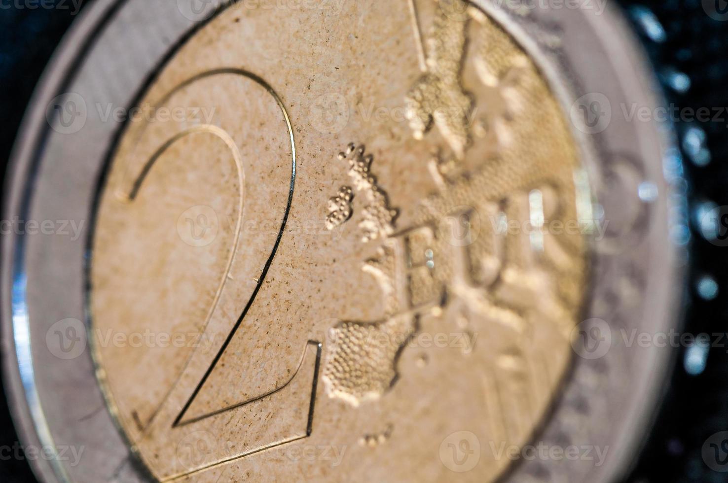 Nahaufnahme von zwei Euro-Münz-Nahaufnahmen foto