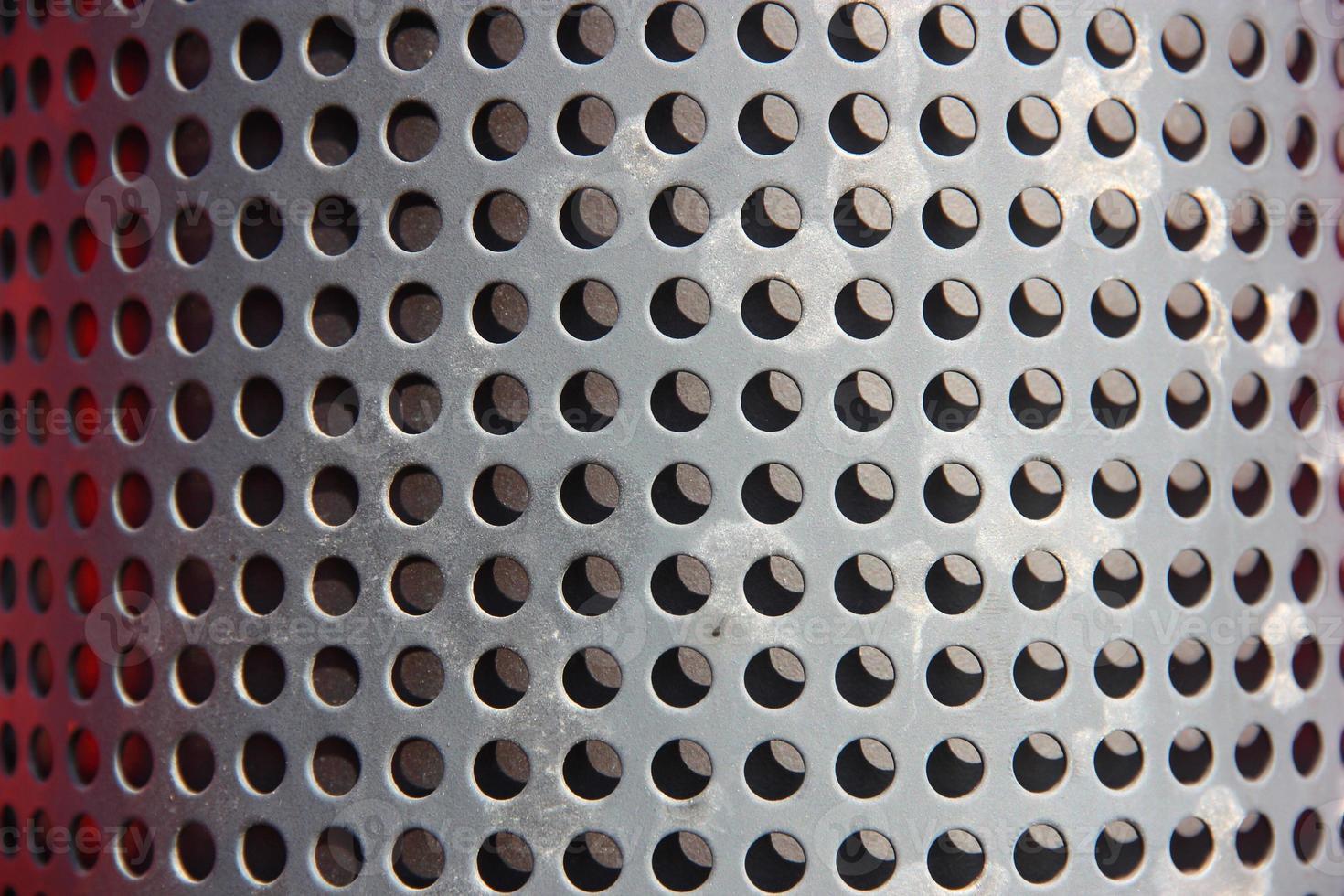 Metallloch oder perforierter Gitterhintergrund foto