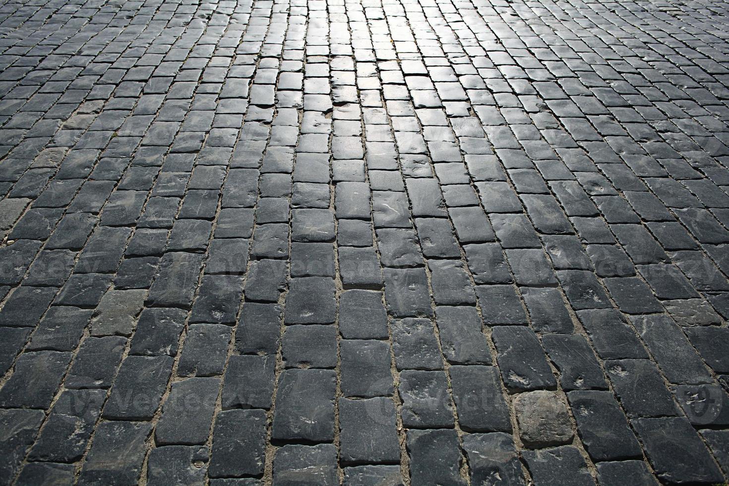 Steine, die den alten Texturhintergrund pflastern foto