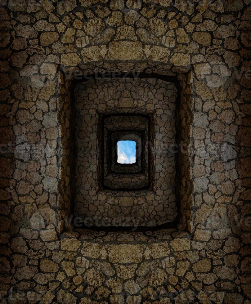 Verlies mit Steinmauern und hellem Fenster hoch oben foto