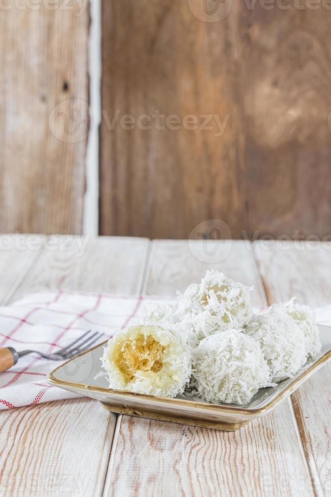 Die thailändische Kokosnuss Munchkin süß schmeckt köstlich auf Holz foto