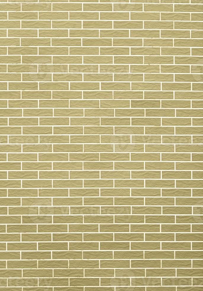 Nahaufnahme der gelbgrünen Backsteinmauer als Hintergrund oder Textur foto