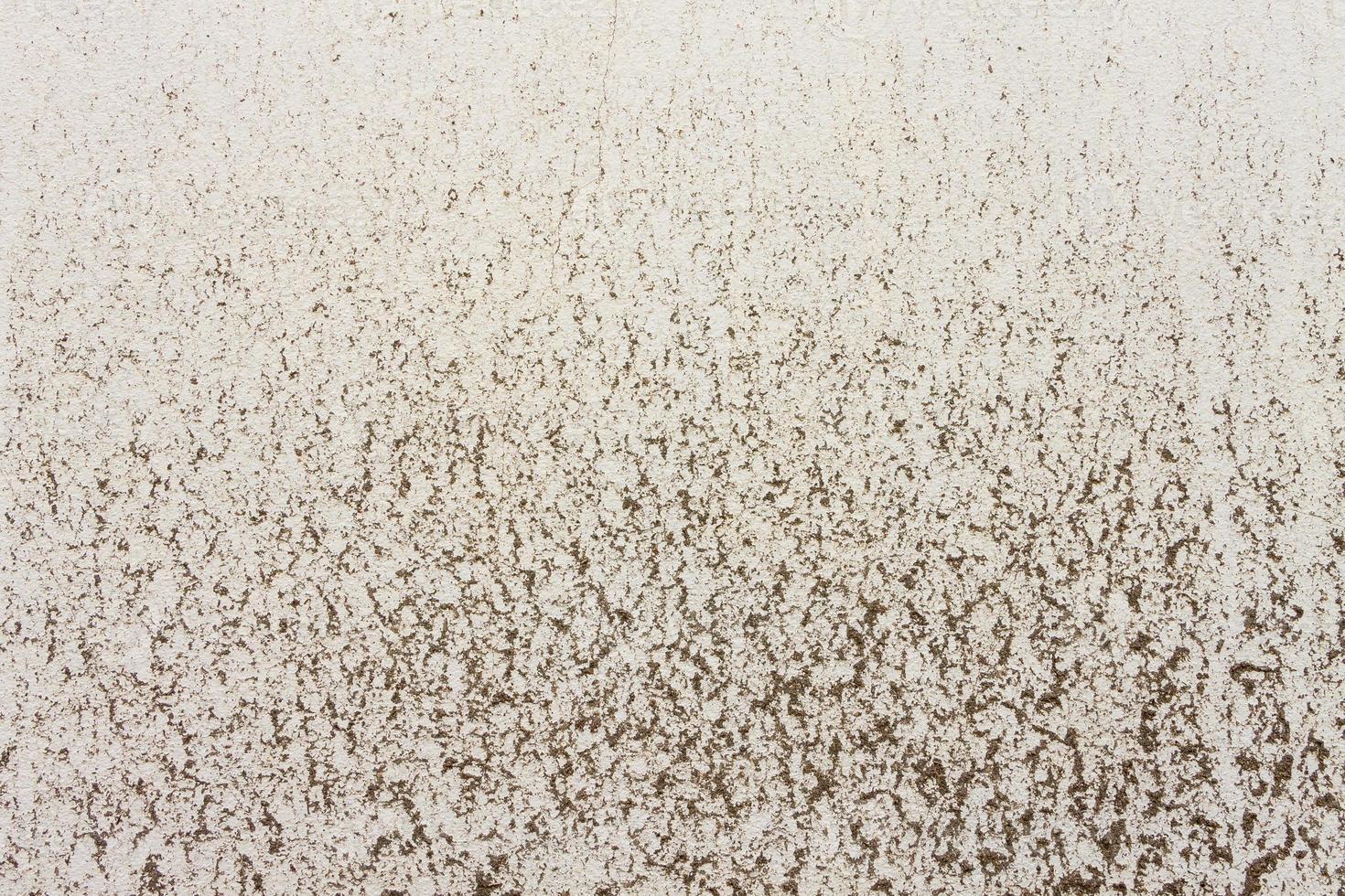 Tonflecken auf gelbem Betonbeschaffenheitshintergrund foto