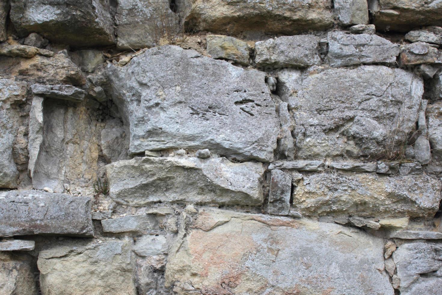 architektonische Hintergrundbeschaffenheit der alten Backsteinmauer foto