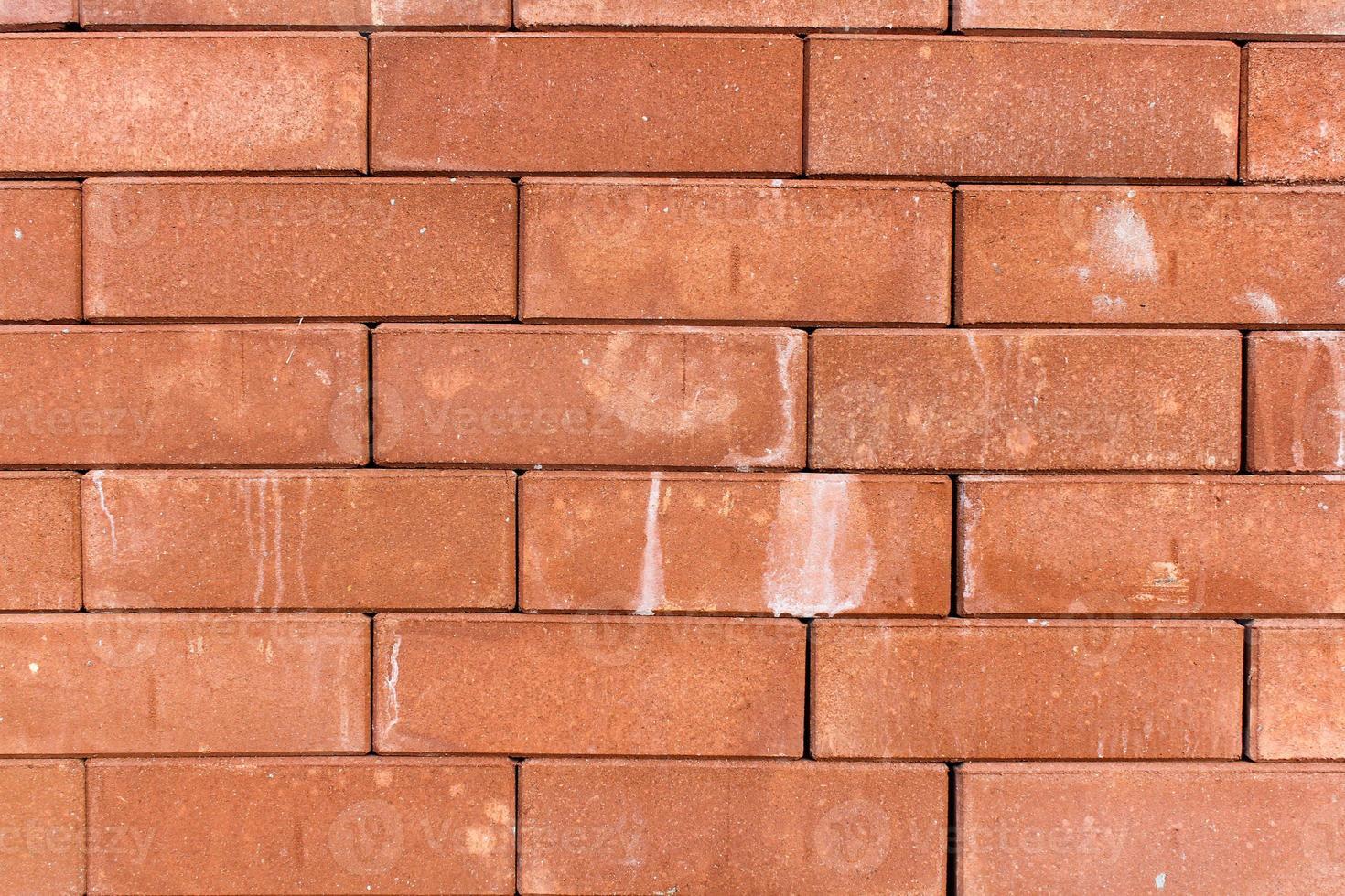 orange Blockwand könnte für Hintergrundtextur verwendet werden foto