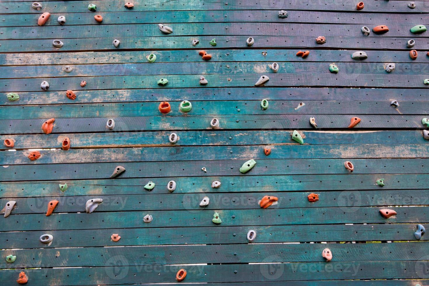 Grunge-Oberfläche einer künstlichen Kletterwand foto