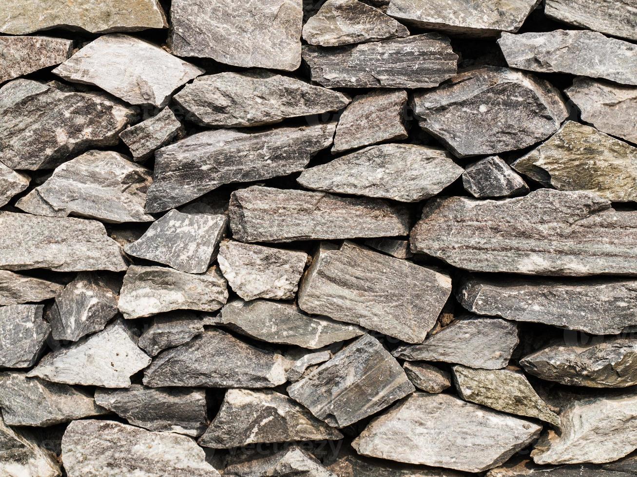 Nahaufnahme der Steinmauer für Hintergrund foto