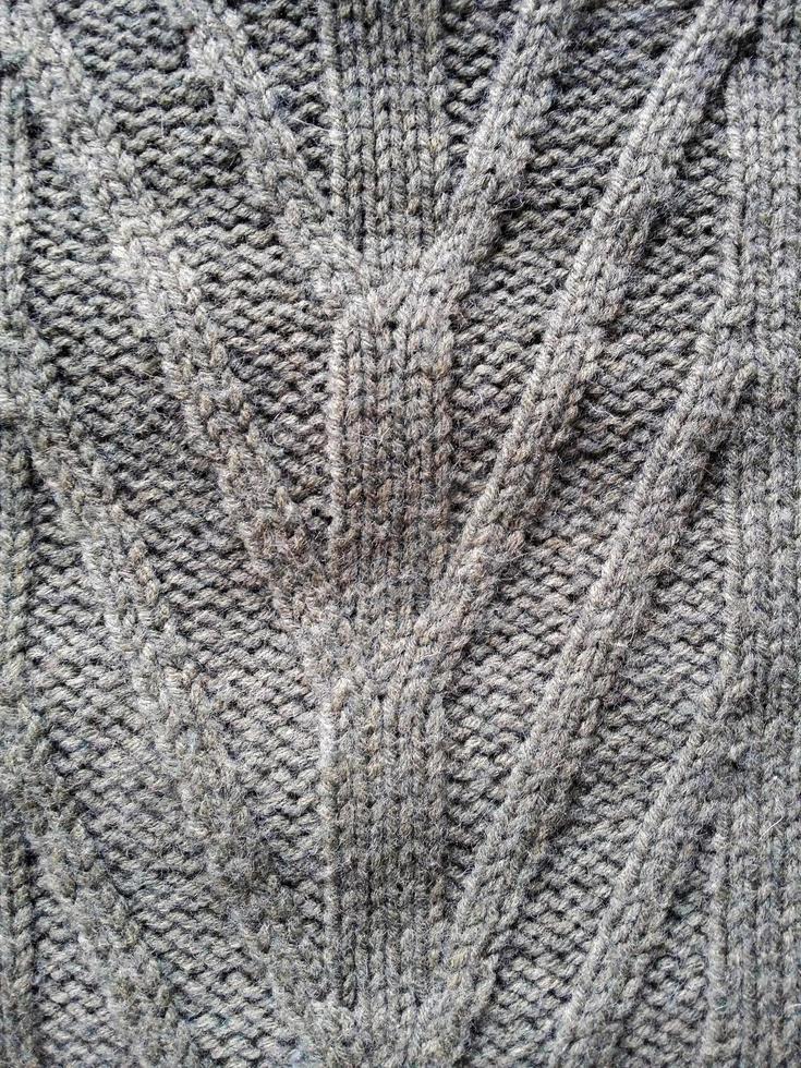 grauer Hintergrund der Strickwollebeschaffenheit foto