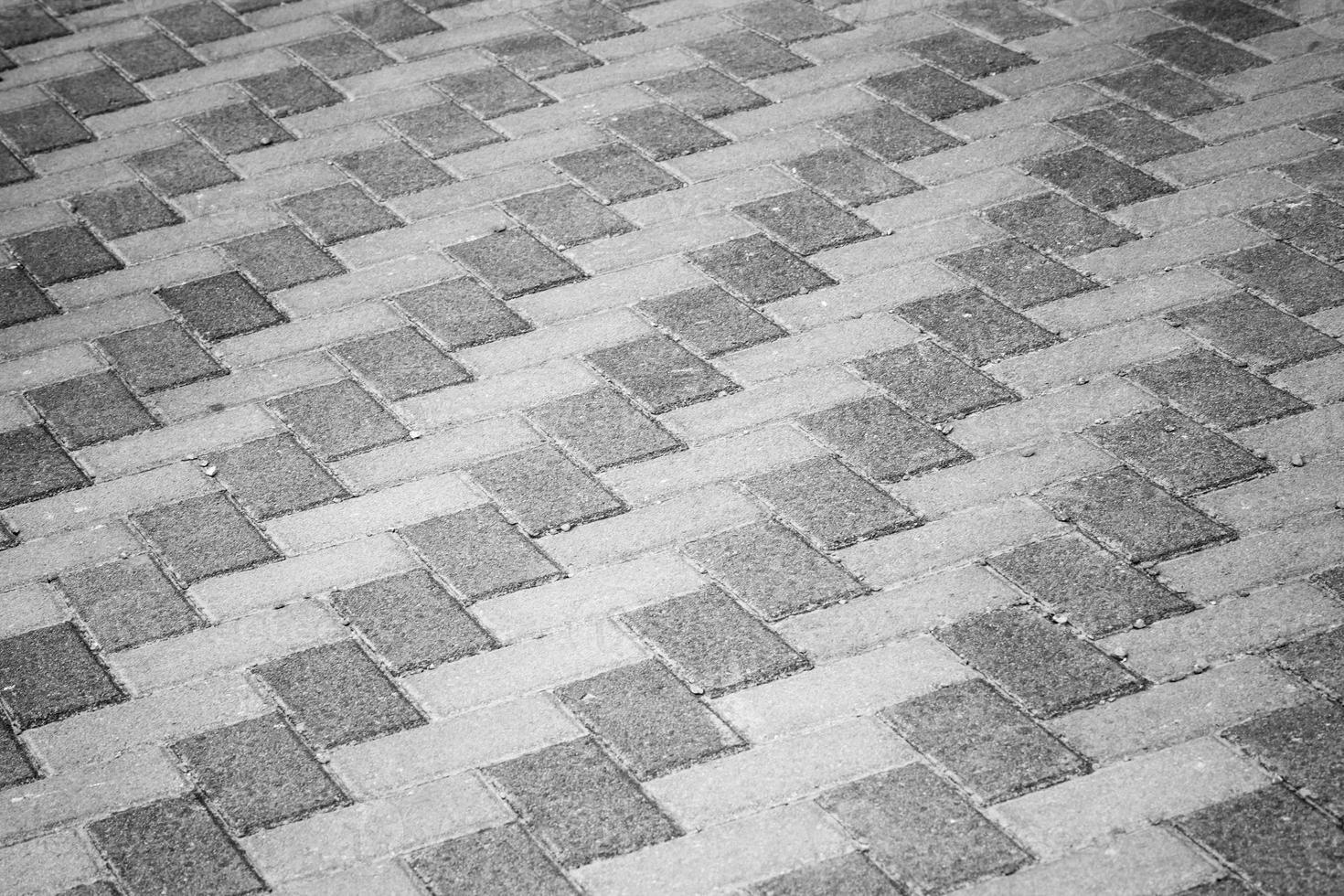 graue städtische Straßenrandpflasterhintergrundfotobeschaffenheit foto